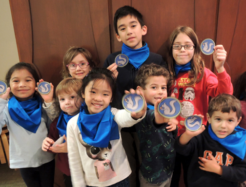 kids holding ranger badges